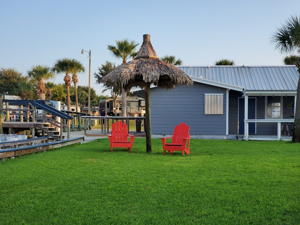 Relax under a palapa at Emerald Beach RV Park