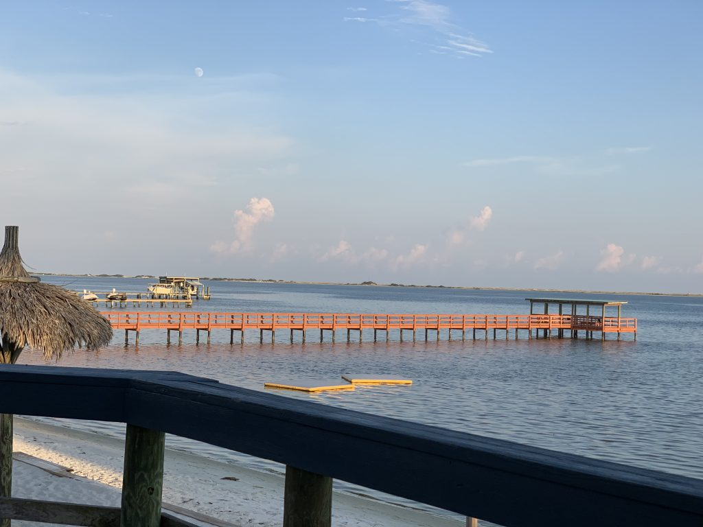 View of private beach and pier at Emerald Beach RV Park
