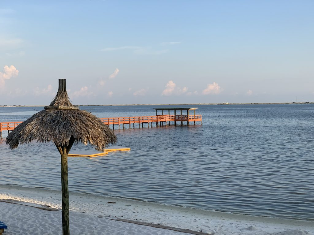 Floating islands, pier, and private beach at Emerald Beach RV Park